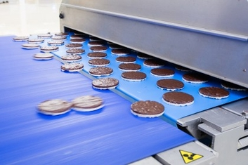 Production of chocolate rice biscuits in food industry plant