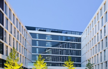 Outside view of a hotel with glass and steel construction